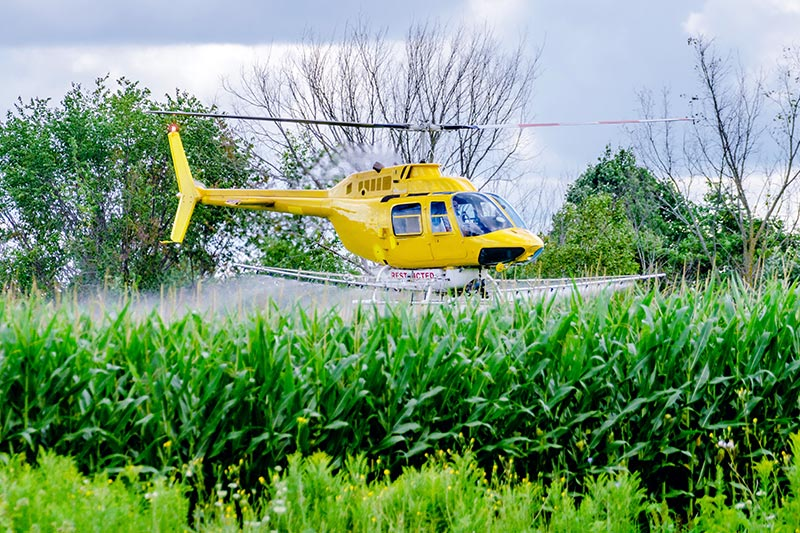 Agricultural Helicopter Spraying in Texas